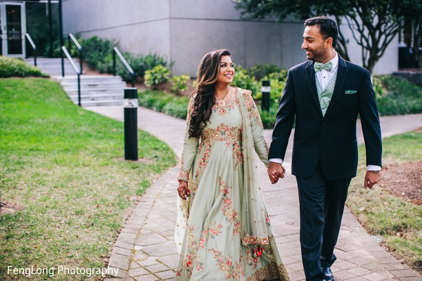 Lovely indian couple walking holding hands