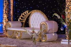 Elegant Indian wedding mandap seat decor.