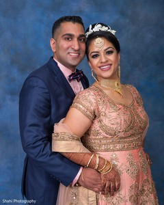 Elegant Indian bride and groom's wedding reception fashion.