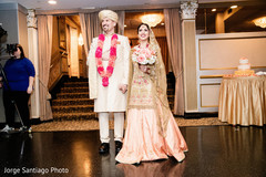 Lovely indian newlyweds entering their reception