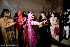 Guests saying good bye to indian newlyweds