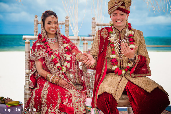 Cute indian couple showing their wedding rings
