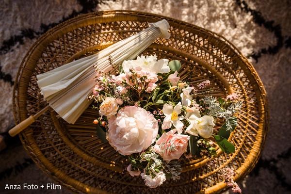 Marvelous Indian wedding flowers and umbrella decoration.