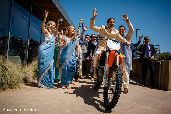 Indian groom happy to arrive during the baraat celebration.