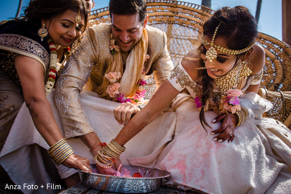 Indian bride, groom and family member during a  ceremony ritual.