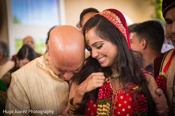 Lovely Indian bride's capture during wedding ceremony moment.