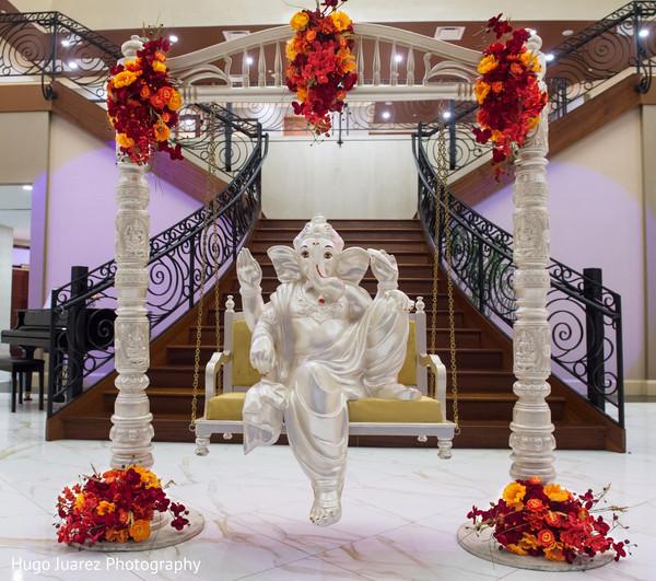 Stunning Indian ceremony Ganesha Puja decoration.