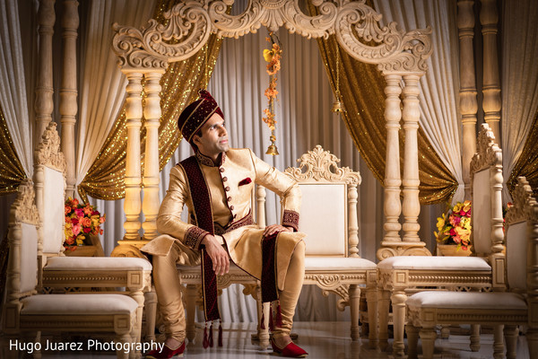 Gorgeous Indian groom ready for wedding ceremony.