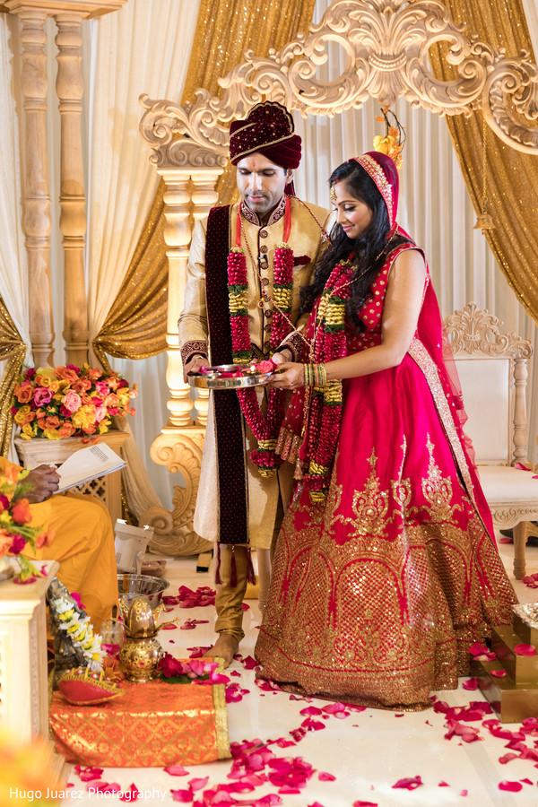 Joyful Indian bride and groom at their ceremony celebration portrait.