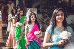 Beautiful indian bridesmaids making their entrance to wedding ceremony