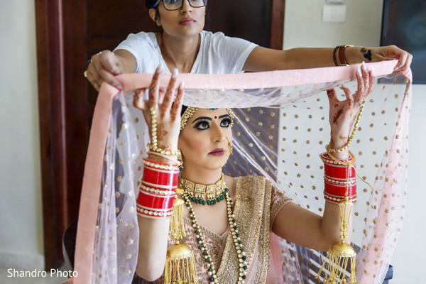 indian wedding gallery,indian bride,bridal jewelry,indian bride getting ready,ghoonghat