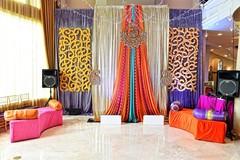 Colorful Indian wedding mandap decorations capture.
