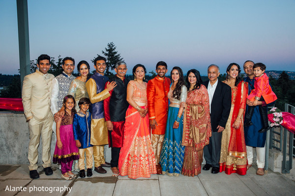 Indian bride and groom with family portrait