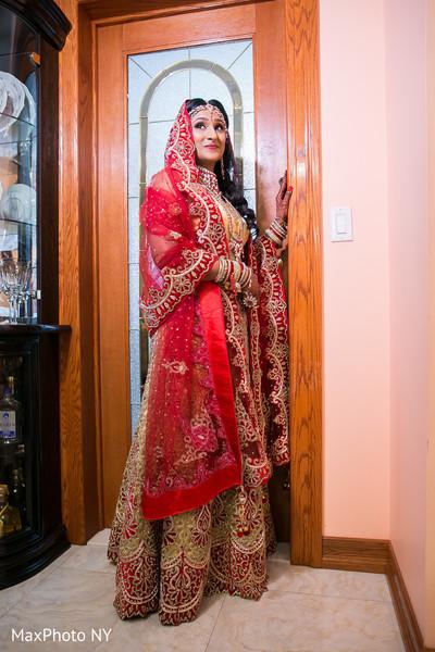 Indian bride glowing in her wedding attire.