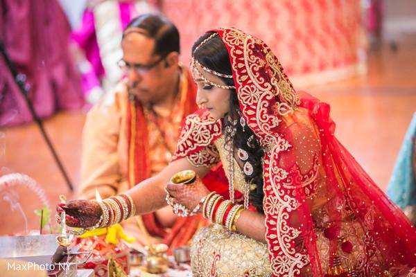 Sweet indian bride during wedding ceremony