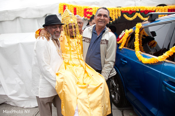 Indian groom being lifted up capture
