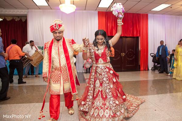 Indian lovebirds joyful entrance to reception
