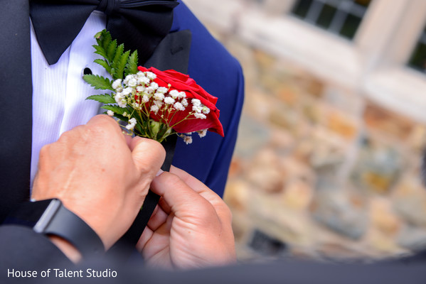 Indian groom getting his Boutonniere on.