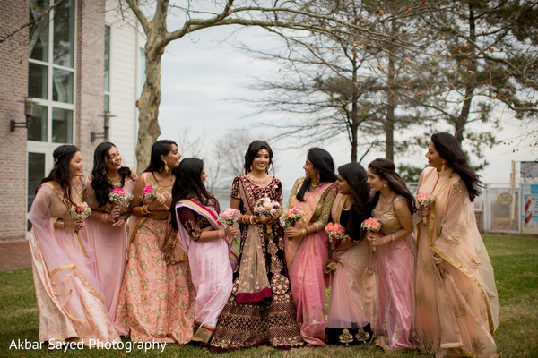 Joyful indian bride with bridesmaids capture