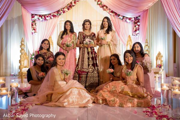 Indian bride with bridesmaids capture