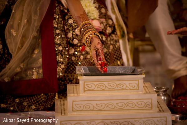 Indian bride making offerings