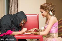 Mehndi artist at work