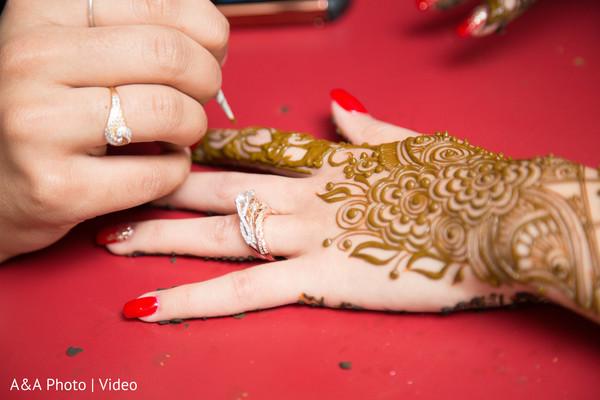 Henna artist making mehndi art
