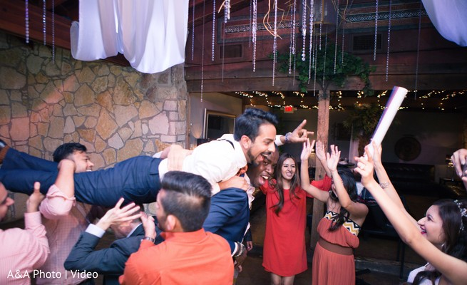 Indian groom being lifted up