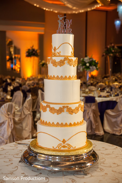 Lovely white and gold indian wedding cake