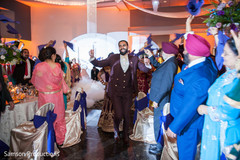 Indian groom dancing during entrance