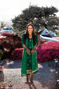 Ravishing indian bride showing mehndi art