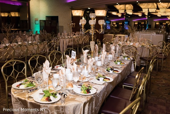 Dreamy Indian wedding reception table chandelier decoration.
