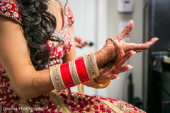 Indian bride getting ready putting her bangles on.