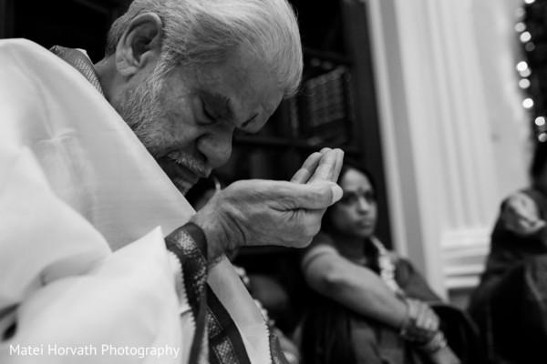 Indian wedding priest praying