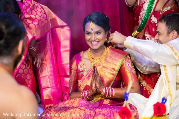 Joyful indian bride during wedding rituals