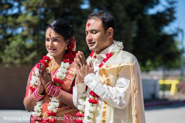 Indian bride and groom praying