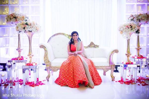 Charming Indian bride posing on the wedding reception mandap.