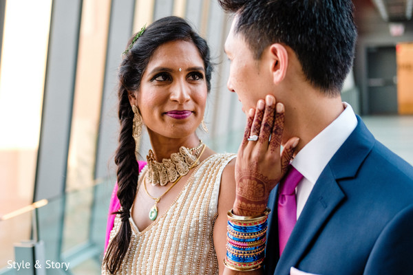 Romantic Indian bride and groom looking into each others eyes capture.