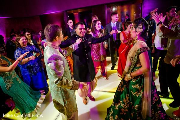 Upbeat dance during the sangeet celebration capture.