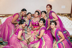 Glamorous indian bride posing with bridesmaids