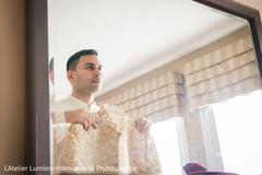 Enchanting indian groom getting ready