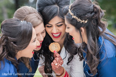 Indian bride with bridesmaids fun moment