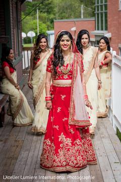 Dazzling indian bride with bridesmaids capture