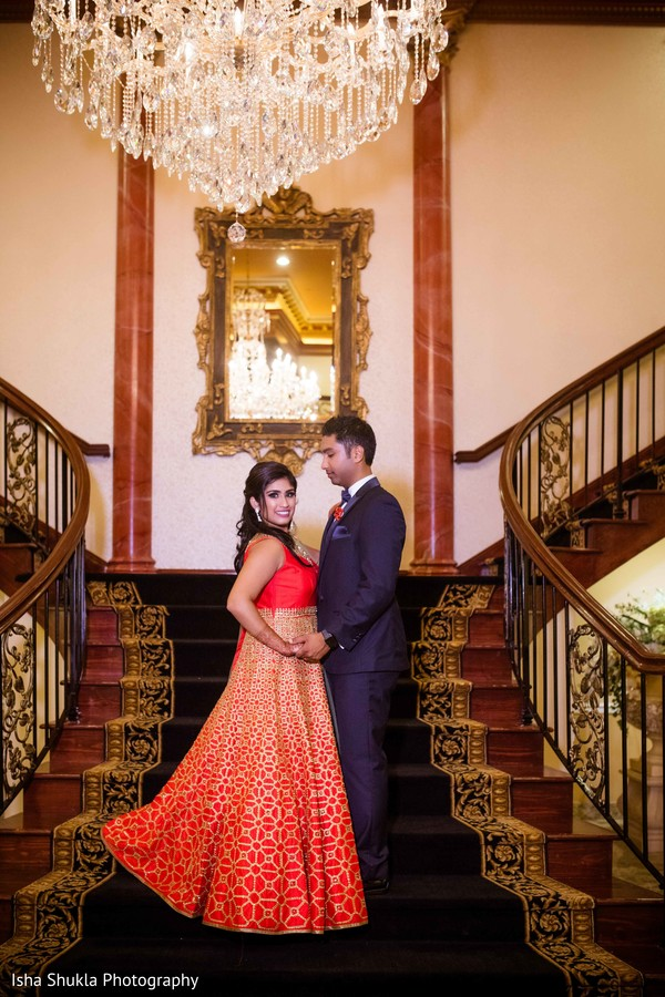 Indian bride and groom sweet reception portrait.