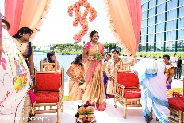 Indian bride entering wedding mandap