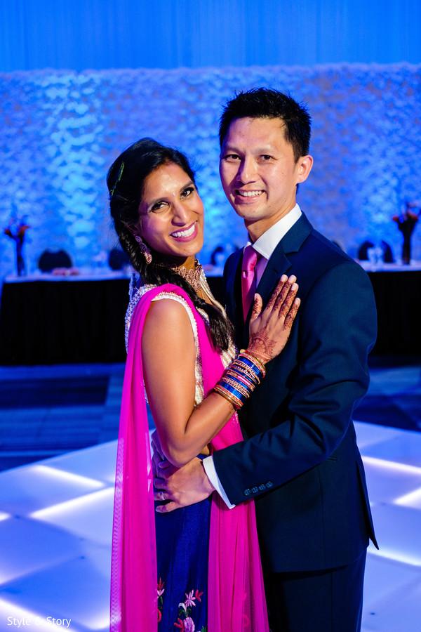 Marvelous Indian lovebirds portrait at wedding reception.
