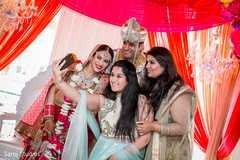 Dreamy indian bride and groom  posing with family members photography