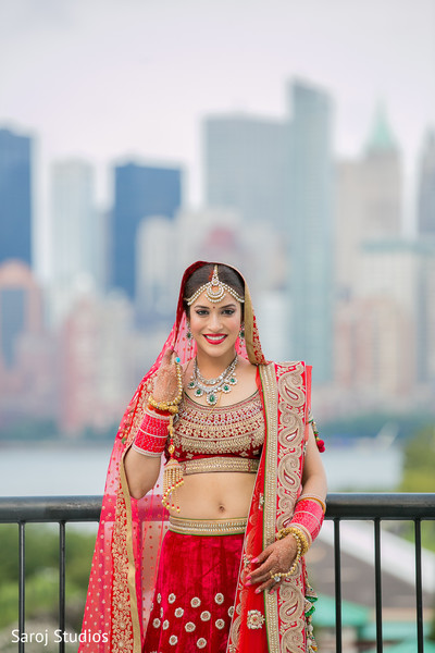 Adorable Indian bride looking to camera capture.
