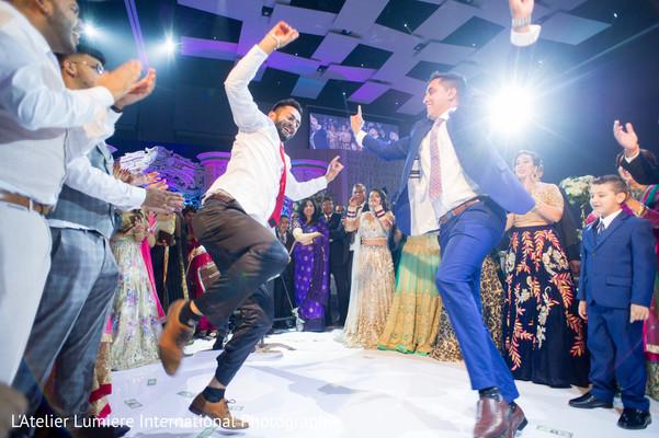 Indian groomsmen dancing during reception
