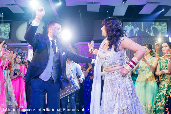 Adorable indian couple dancing during reception